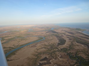 Rivers meet the Golf of Carpentaria. Moon top centre.